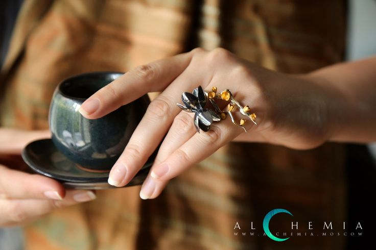 The Sakura ring. Blackened silver. The Spring ring. Gilded silver, satin cover. Handmade by Alchemia Jewellery.