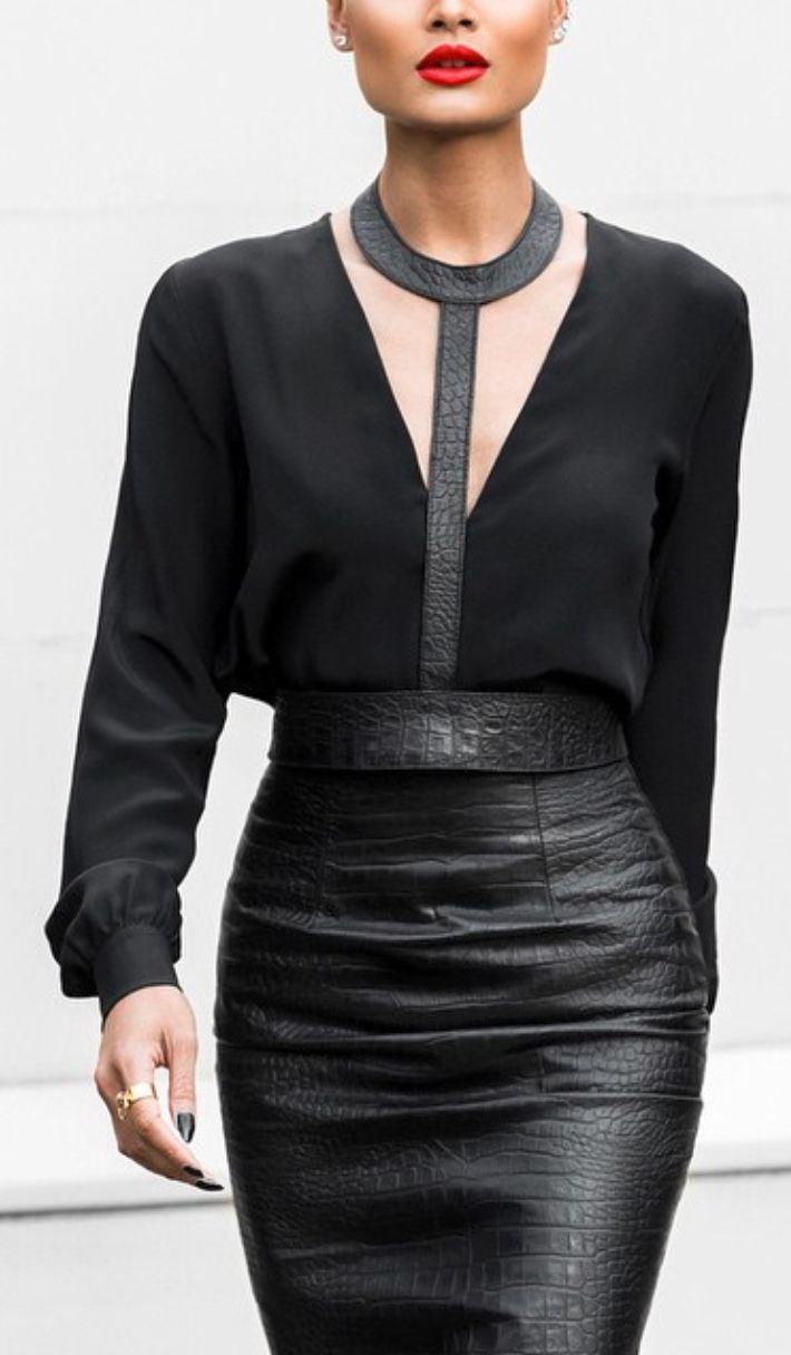 Leather skirt with black blouse