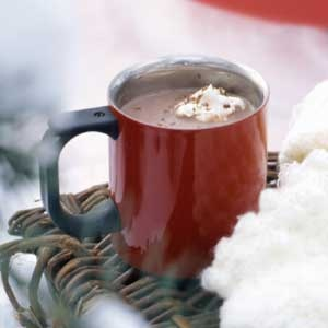 in a mug. This homemade hot cocoa is swirled with chocolate-caramel ...
