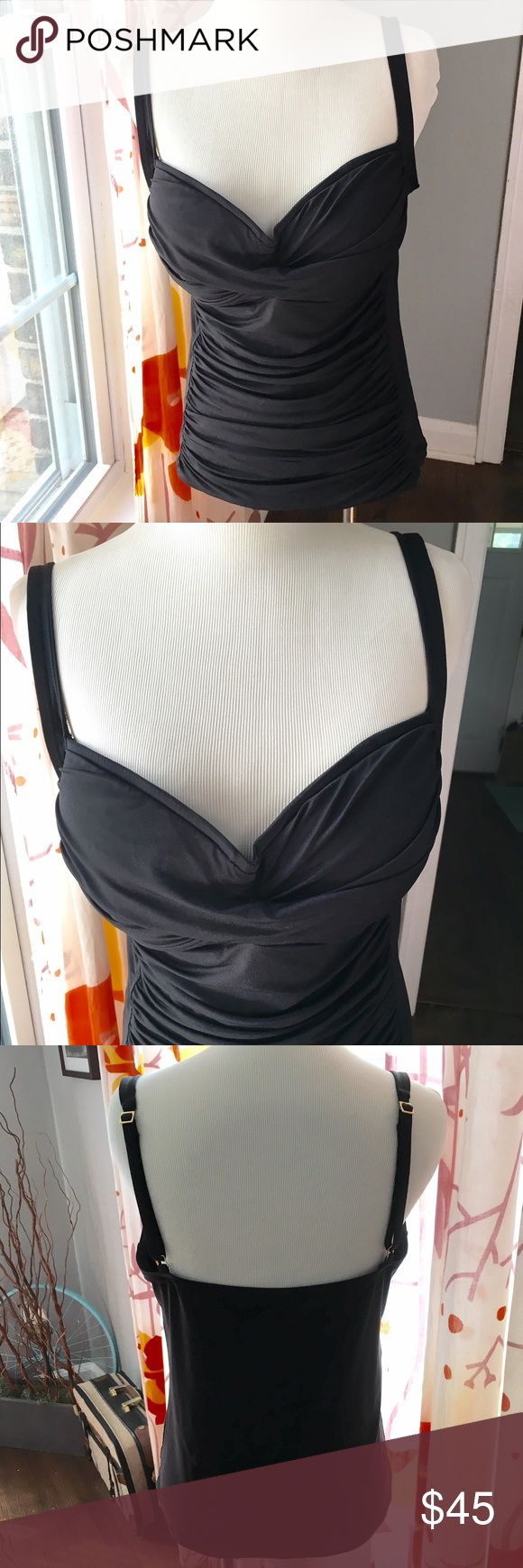 La Blanca slimming tankini, size 14, black La Blanca slimming tankini, size 14, black m, top only, beautiful. Great condition, adjustable straps. Purchased at Nordstroms La Blanca Swim