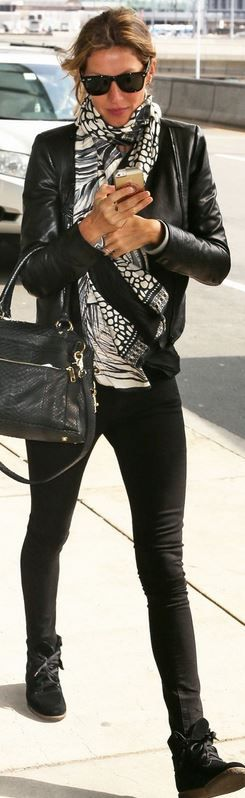 Who made  Gisele Bundchen's black sunglasses, snake print handbag, white print scarf, and sneakers that she wore at LAX airport?