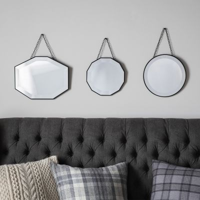 Glass framed scatter mirror set of 3. These hanging mirror comes in a variety of shapes adding decorative flair to your wall