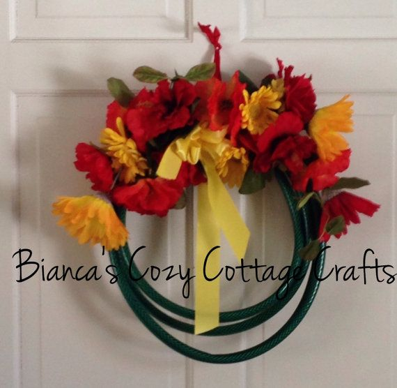 Colorful garden hose wreath / doorhanger by BsCozyCottageCrafts