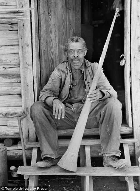 Former Slave holds a horn with which Slaves were called. (near Marshall, Texas)