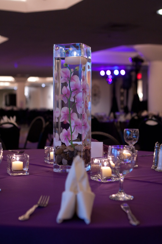 DIY Wedding Centerpiece  Tall square vase with river rock, silk orchid stem, and floating candle