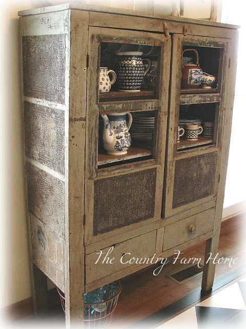Blue dishes in an old pie safe (from The Country Farm Home)