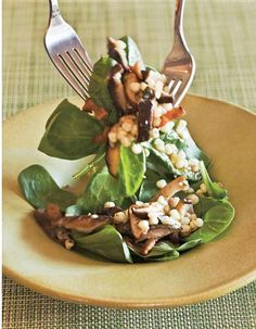 Warm spinach salad with shiitakes, corn and bacon