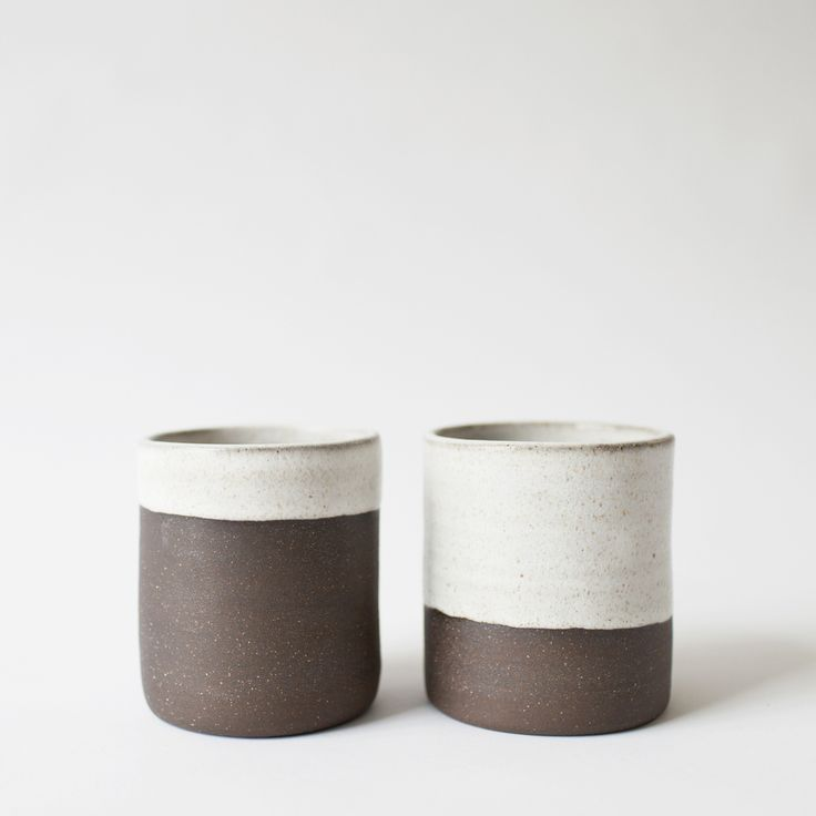 We're digging this combination of black clay and white glaze and these cups are big enough to hold a couple of ice cubes and a healthy pour of whisky. This posting and price is for the two cups pictured. Artist: Sam Nichols