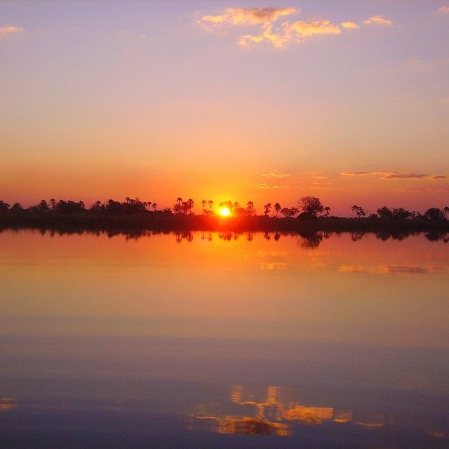 Our first pic is an #Okavango #Sunset. #NoFilter #NoFilterNeeded #Africa #Botswana #Reflections. To find out more about our products go to -->www.wildfrontiers.com<--
