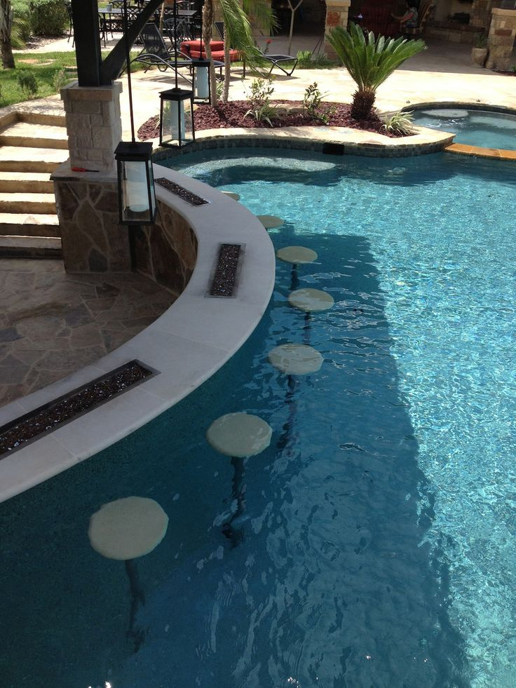 This is the life! When you build a pool, make sure you add a swim up bar to the design. Looks like a great spot to relax on a warm San Antonio afternoon :)