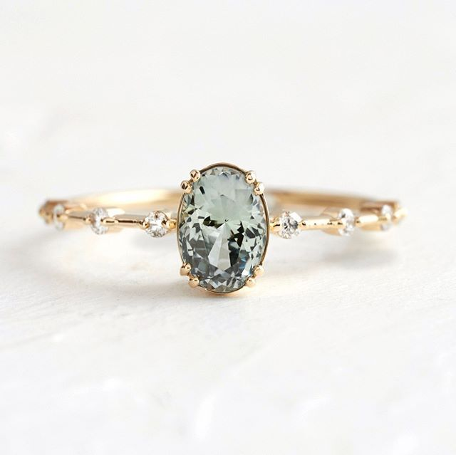 A New Sapphire Distance Ring This Center Stone Is A 7x5mm Montana Sapphire With A Pale Gre Colored Engagement Rings Green Sapphire Ring Green Wedding Jewelry