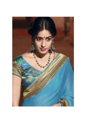 Simply plain dark turquoise color saree is reach to an another level of elegance with its printed silk blouse piece.