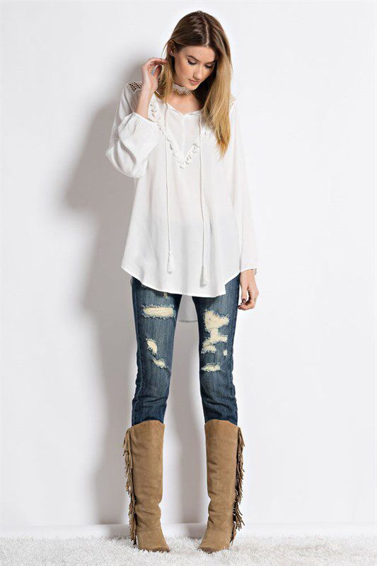 White peasant shirt.  Wear it casually or dress it up. https://www.facebook.com/kleeboutique/