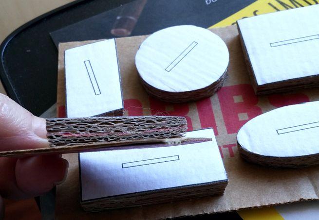Puxadores: camadas de papelão coladas