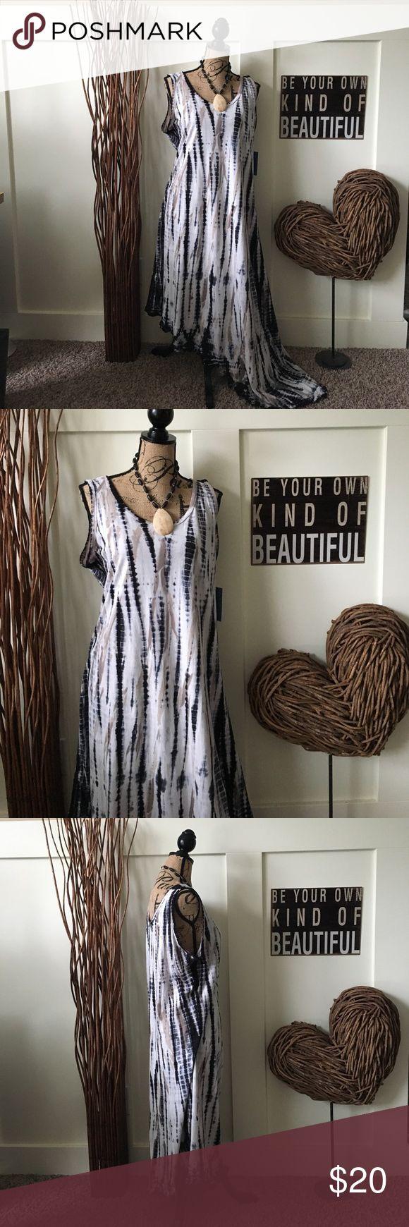 Lulu-B, asymmetrical tie dye dress Cream khaki and black tie-dye dress has an asymmetrical longer side. Super cute with your favorite flip-flops or dress it up with your favorite heels for a night out. lula b Dresses Asymmetrical