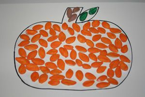 Pumpkin Seed Pumpkin Art- This fun and easy Fall activity is perfect for your 2-4 year olds! It's also a great way to use those seeds leftover from pumpkin carving.