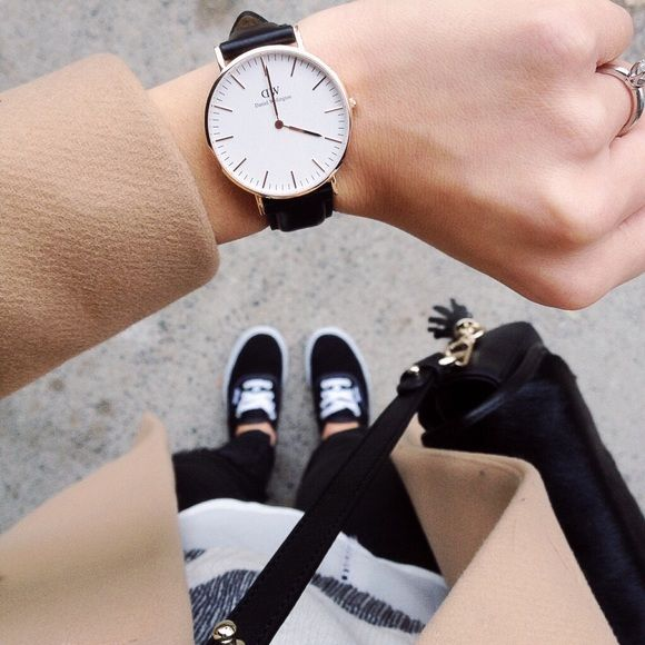 Daniel Wellington watch Brand new inspired Daniel Wellington watch , 40mm , gold face with black straps . Fast shipping and quality guaranteed! Get it before it goes Daniel Wellington Accessories Watches