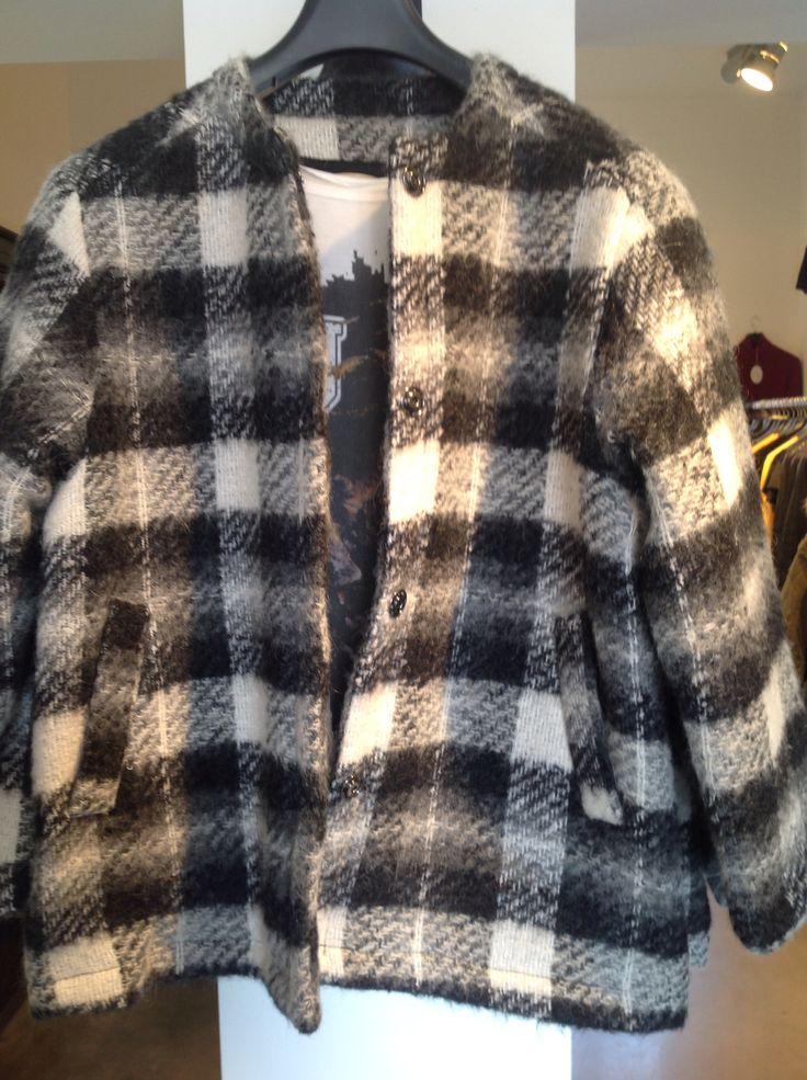 En varm overgangsjakke i uld med termo indvendigt  førpris 1799kr NU 1099kr