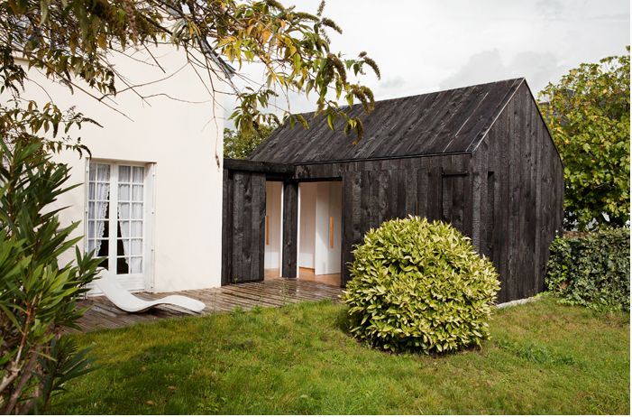"""On the coast of Brittany sat """"a vacation home frozen in time."""" The architects' challenge was to add a bedroom to the tiny white cottage—without sacrificing any of the quaint atmosphere. The solution? They built a mirror image."""