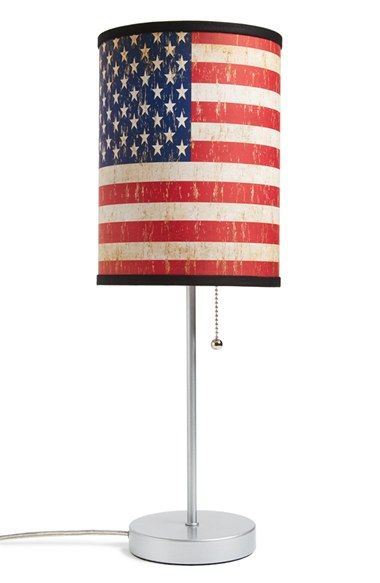 Adding patriotic decor to the house with an American flag lamp.
