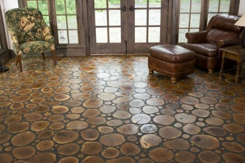 """Amazing flooring! (Logs & Twigs Flooring)   Americana at its finest, this rustic flooring from Chicago-based Birger Juell is almost like a modern day tribute to the log cabin. Each of these """"tiles"""" is a cross-section from the leftover ends of a tree trunk or branch. Although each round is sanded and then oiled for protection, the natural wearing of the wood still allows for occasional minor splits and cracks, which only adds to the floor's personality."""