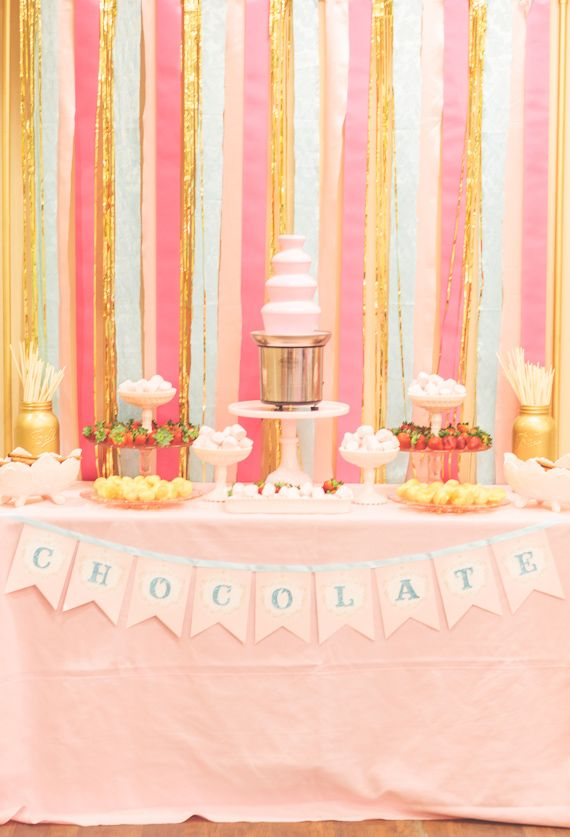 Chocolate fountain with fruits and cookies for party dessert