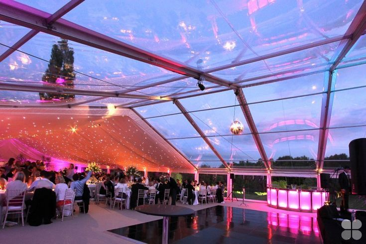 Clear PVC roof marquee with stylish semi-circular bar and starlight linings by Academy Marquees