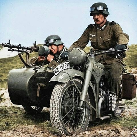 A BMW R75 motorcycle and side car with personnel