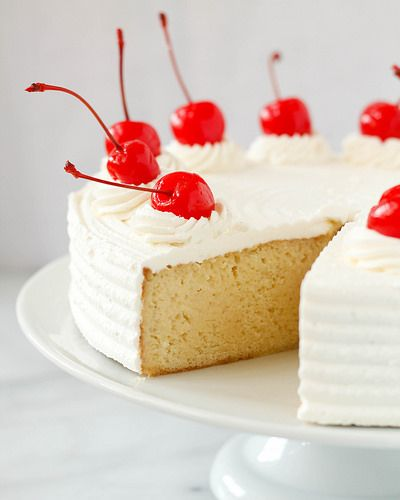 Treats: Tres Leches Cake / Milk Mixture 1 (14-ounce) can sweetened condensed milk  1 (12-ounce) can evaporated milk  1 cup heavy cream  1 teaspoon vanilla extract  Cake 2 cups all-purpose flour  2 teaspoons baking powder  1 teaspoon salt  1/2 teaspoon ground cinnamon  8 tablespoons (1 stick) unsalted butter  1 cup whole milk  4 large eggs, room temperature  2 cups sugar  2 teaspoons vanilla extract   Frosting 1 cup heavy cream  3 tablespoons corn syrup  1 teaspoon vanilla extract