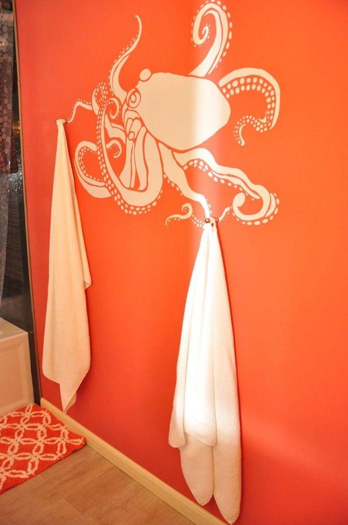 Octopus stencil in bathroom. Towel holder.