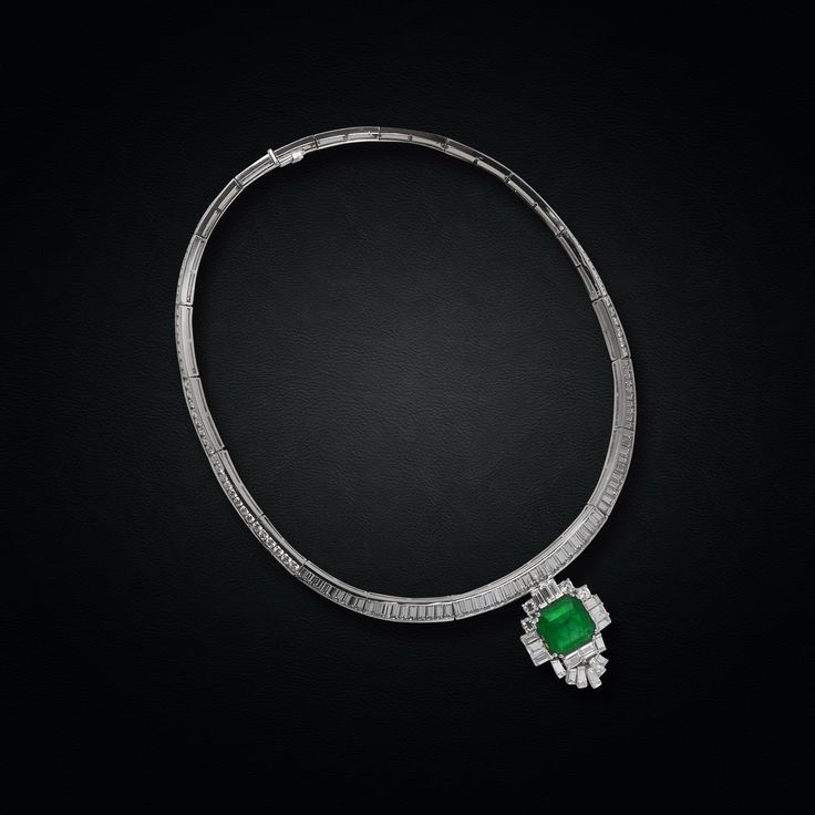 Spectacular Art Deco Diamond Pendant centering a Colombian Emerald mounted in 18K White Gold