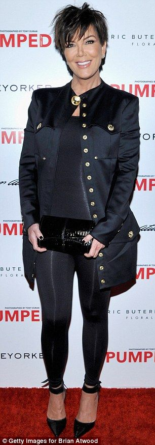 Uh oh: Kris protected her modesty with a strategically placed clutch bag out of fear she w...