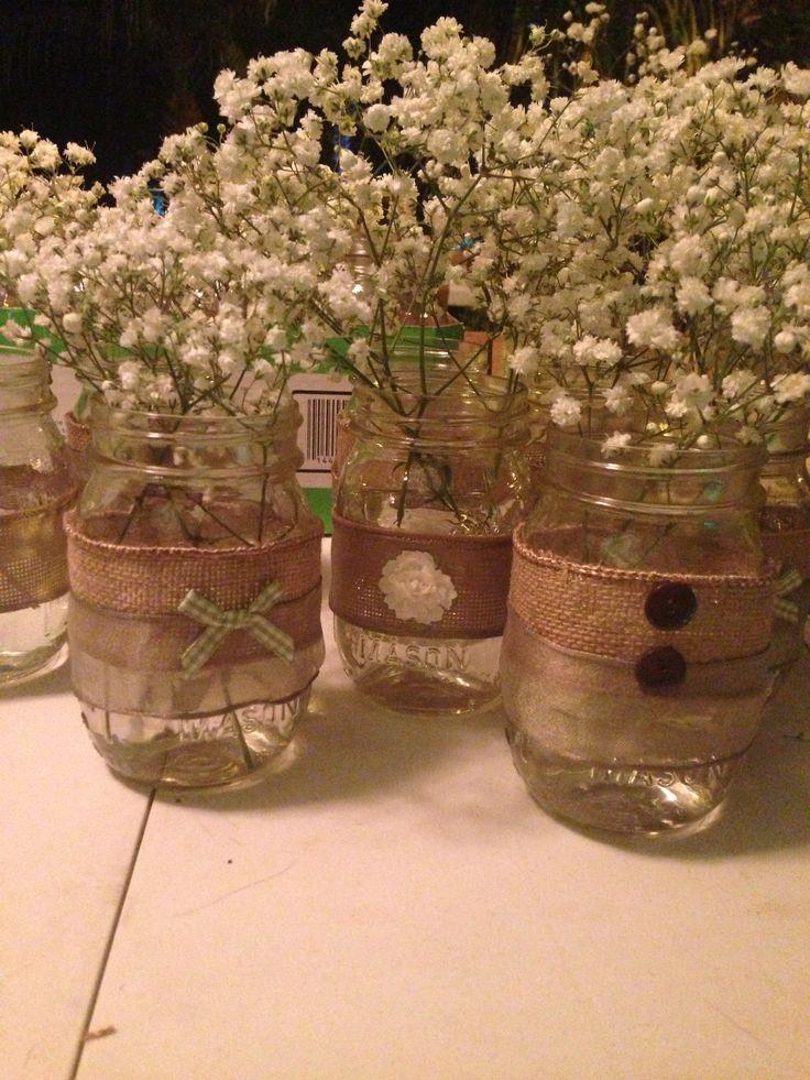 Vintage rustic baby shower/ wedding mason jars--minus the baby's breath, perhaps with wildflowers (in Feb?)