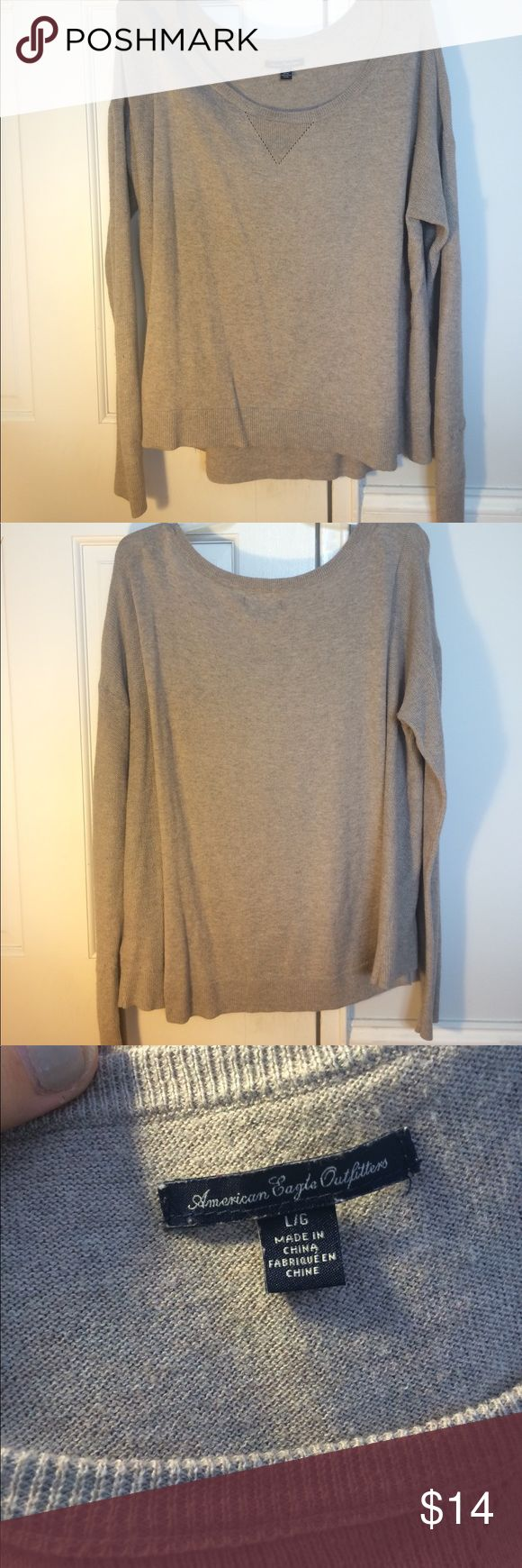 LARGE American eagle sweater!! This tan sweater is perfect for the fall!! It is a lighter material, long sleeved with intricate thinner material on the sleeves!! It is a little longer in the back- perfect to wear with leggings! However it has a minor thread stitching problem on the inside on the right arm- not very noticeable when worn! American Eagle Outfitters Tops Tees - Long Sleeve
