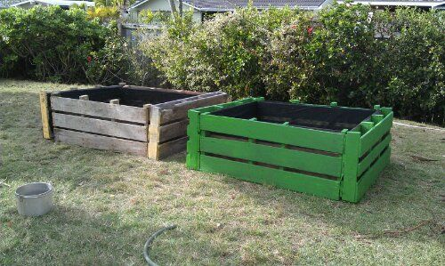 Reuse Pallet wood for raised garden beds--and in John Deere green maybe this would work in our garden