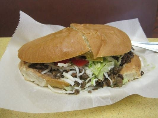 TORTAS  El Rancho Grande Recipe   2  (8 oz.)skirt steaks, thin sliced ( or chorizo, shredded chicken or pork )  4 Bolillos or other crus...
