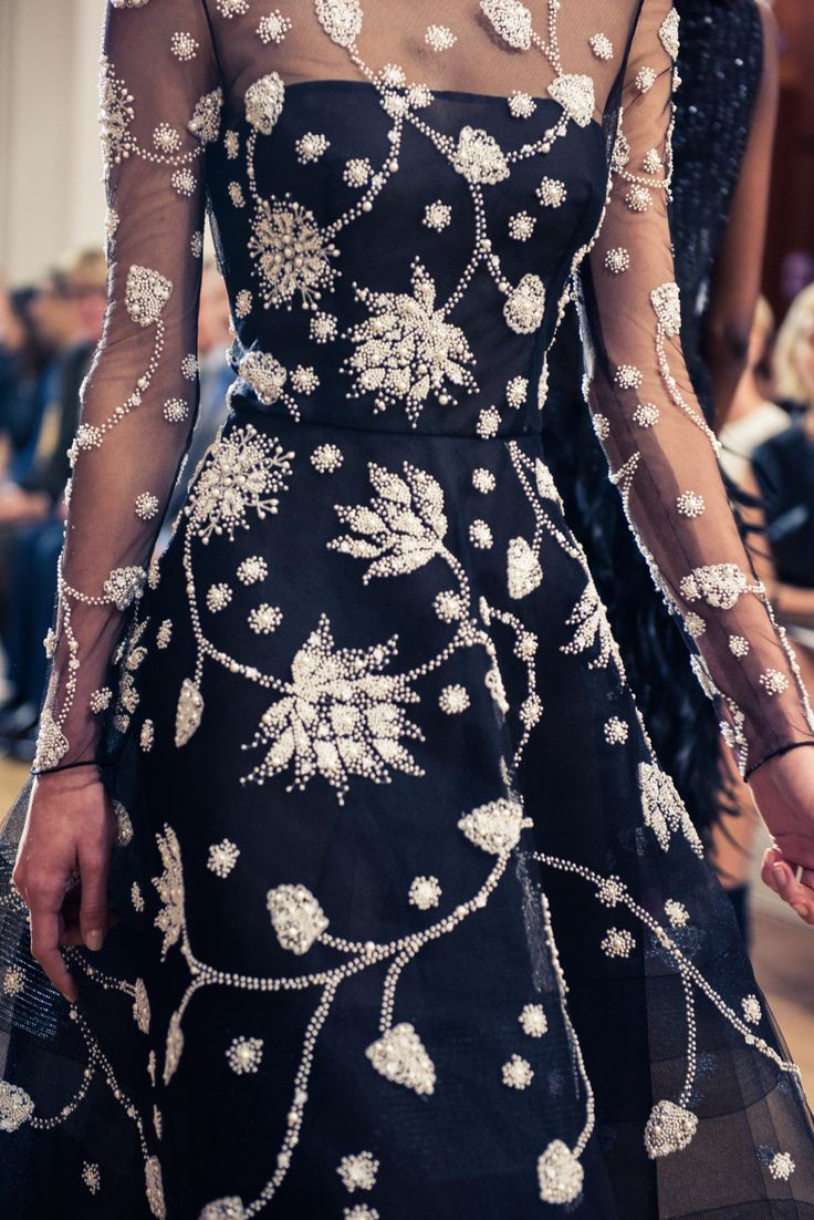 """oscardelarenta: """"Thousands of pearls are hand-embroidered on black tulle to create a breathtaking lotus motif. Photo by The Coveteur """""""