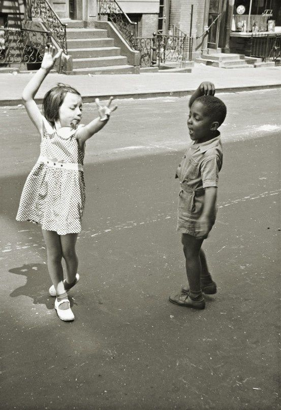 A White Girl And A Black Boy Playing, Dancing Together -9967