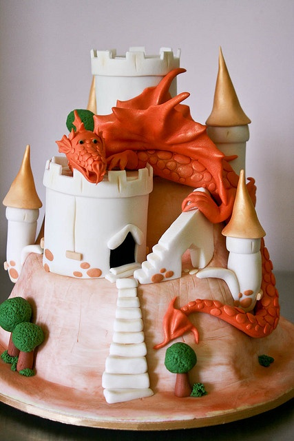 Chocolate Jaffa cake covered in fondant. Dragon was made from icing.