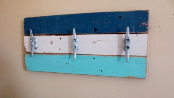 "Boat Cleat Towel Rack Nautical Coat Hooks  THE INSPIRATION: Hurricane Sandy. I live in a coastal community that was impacted by Hurricane Sandy. So many of my neighbor's homes were destroyed. I looked around at all the debris and felt compelled to make something beautiful, ""a-lemons-into-lemonade kinda thing"". My nephew and I put up the fence in my yard; Sandy took it down. Now a piece of that fencing, repurposed into art, hangs in my living room. It serves as a lasting reminder of the…"