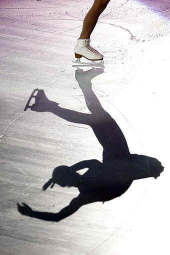 This picture is so interesting because it only shows a small part of the actual person's body. However, the rest of the body can be seen in its shadow. The figure skater is clearly in a difficult position and it is so interesting to see the figure's position only by seeing their shadow, rather than their actual body.