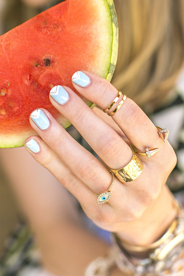 Cute mani, stacked gold rings, and watermelon = summer