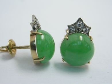 One pair of 14 karat yellow gold pierced earrings. Two round cabochon jadeite jade pieces (9.00 carats: natural medium greyih green colour). Six round brilliant cut diamonds (0.13 carats: VS clarity: G-H colour)