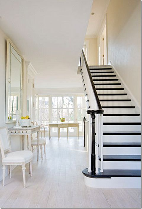 black steps/railing/newell post with white trim and walls