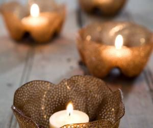 Candle holders made from brown plastic bottles.