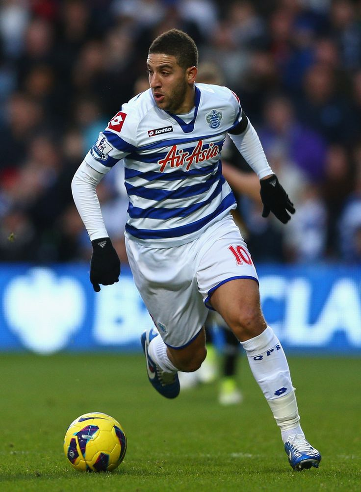 Adel Taarabt Photos - Adel Taarabt of Queens Park Rangers in action during the Barclays Premier League match between Queens Park Rangers and Fulham at Loftus Road on December 15, 2012 in London, England. - Queens Park Rangers v Fulham - Premier League