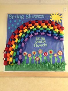 Spring bulletin board. It would be cute to make the rainbow out of student handprints.