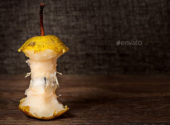 Stub of pear on wooden table - Stock Photo - Images Download here : https://photodune.net/item/stub-of-pear-on-wooden-table/18734574?s_rank=49&ref=Al-fatih
