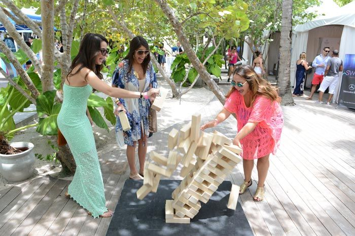 Guests played oversize Jenga at Ocean Drive's Sun Covered pool party at the Raleigh Hotel during Mercedes-Benz Fashion Week Swim.