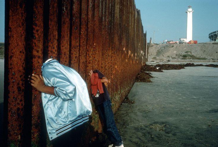 Alex Webb - Mexico. Playa de Tijuana. 1995. At the border fence.